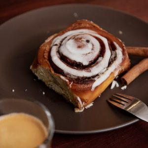 """A slice of Cinni Bun on a plate as the featured image of """"cinni bun sweet goodies""""."""